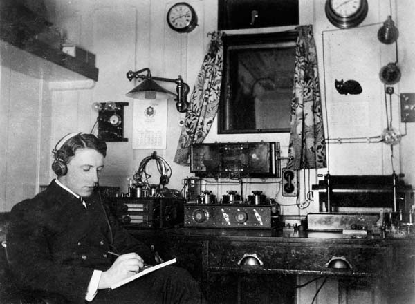 Mr Brent at work in the Marconi Room. A different layout but similarly equipped to that of the Titanic.