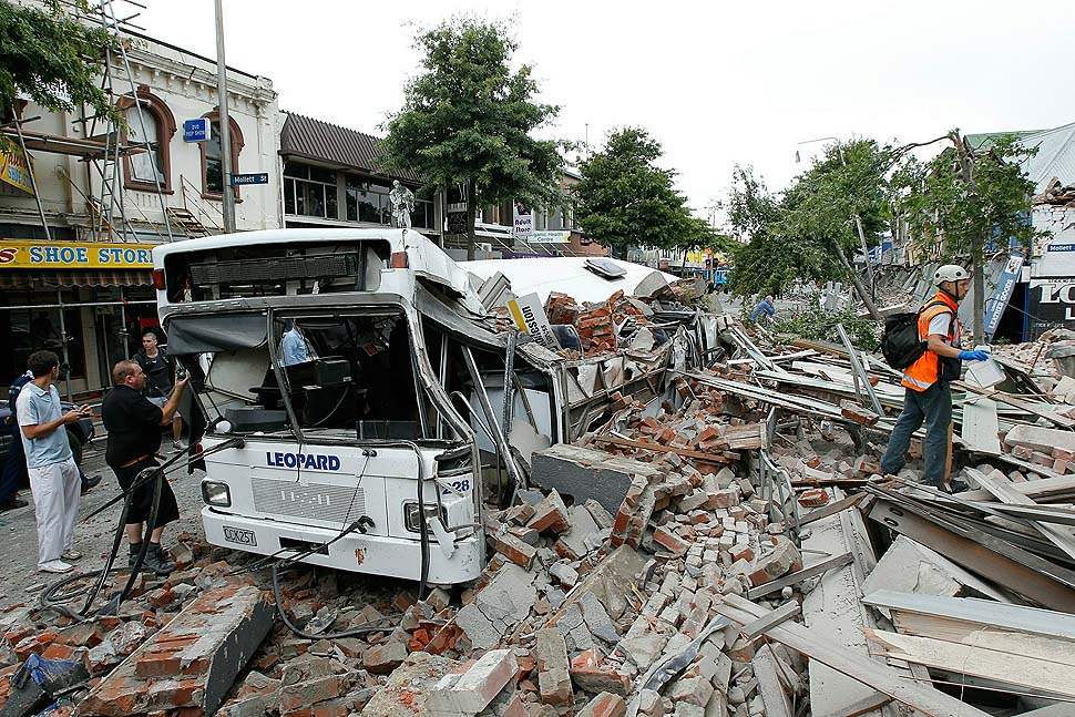 CHRISTCHURCH, NEW ZEALAND - FEBRUARY 23: Bus covered in building debris on February 23, 2011 in Christchurch, New Zealand. The 6.3 magnitude earthquake - an aftershock of the 7.1 magnitude quake on September 4 - struck 20km southeast of Christchurch at around 1pm local time, with initial reports suggesting damage and fatalities far exceeding the initial quake. (Photo by Martin Hunter/Getty Images)