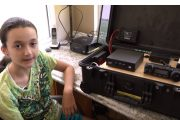 KM4IPF Shows the Shack-In-A-Box Ham Radio Go Box that She Built